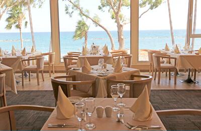 Poseidon Restaurant Poseidonia Beach Hotel Book A Table Cyprus - Book table for dinner